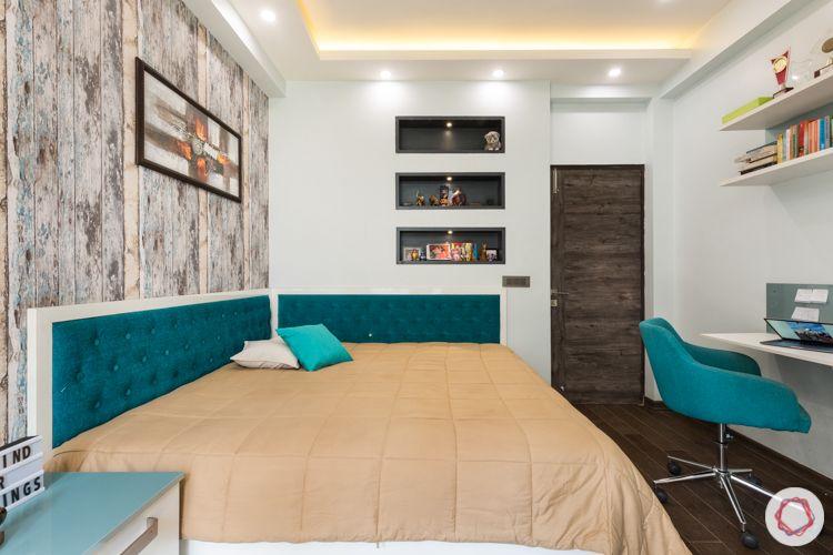 Blue headboard-display niches-wood patterned wallpaper-study unit