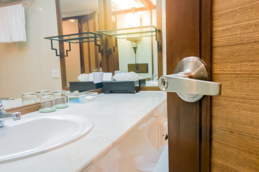Bathroom Vastu-wooden-door-white-sink-towel