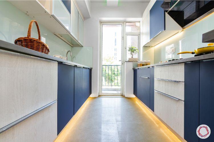 kitchen cupboard colours-blue-white-lights-under-groove-handles