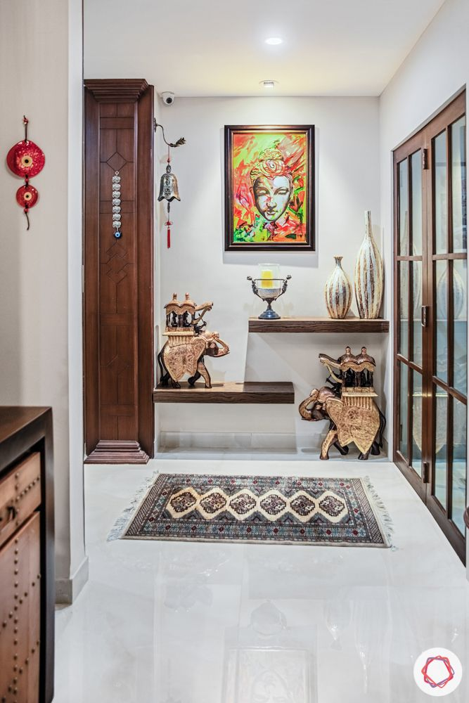 home interiors in chennai-entryway designs-wall art-artefacts-floating shelves