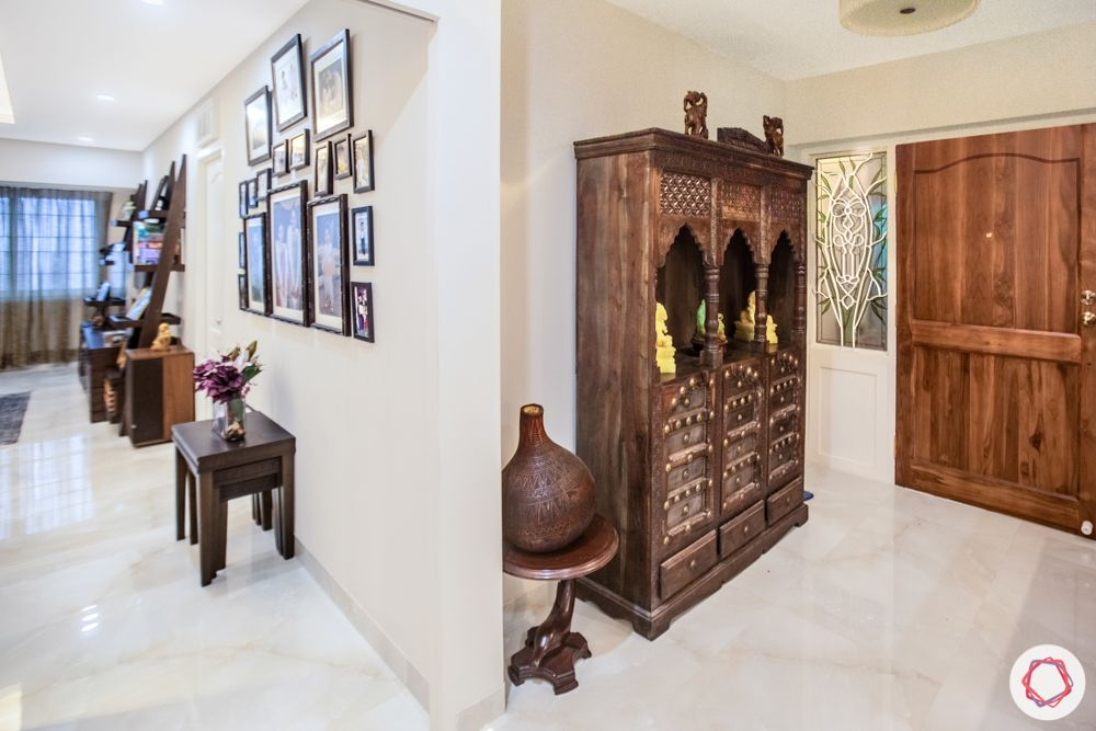home interiors in chennai-carved display unit-wooden door-entryway designs