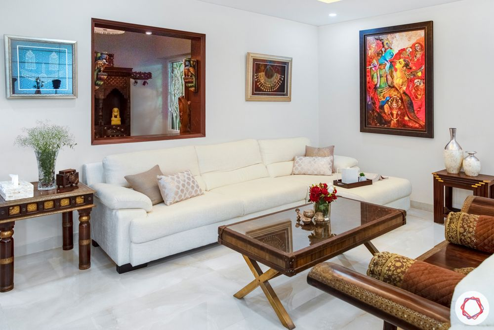 home interiors in chennai-crockery cabinet-swing set-wooden furniture-art work-white sofa