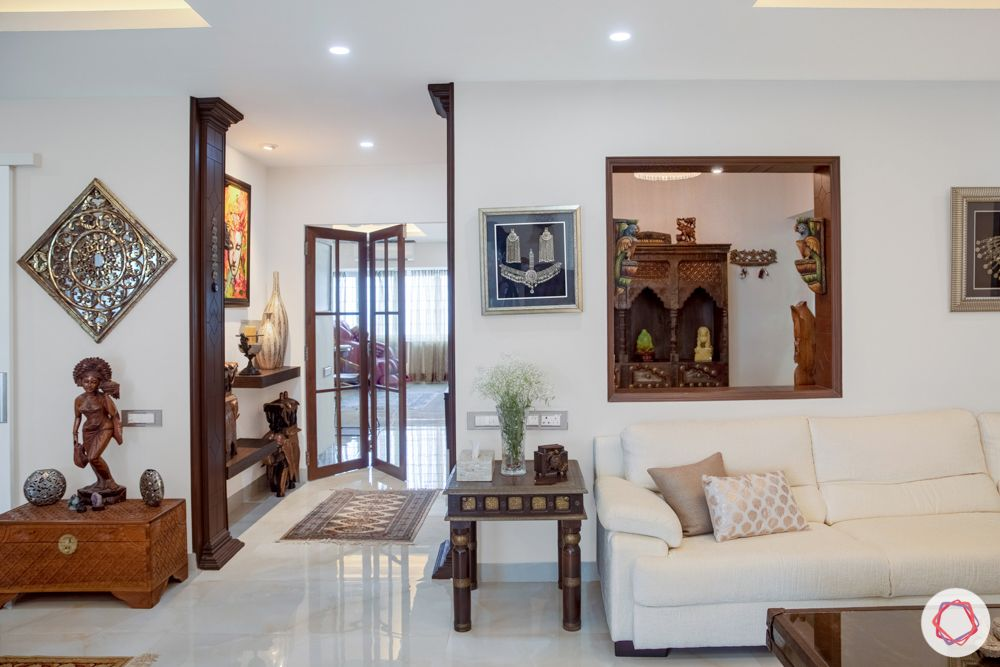 home interiors in chennai-swing set-wooden furniture-art work-white sofa-curios-artefacts