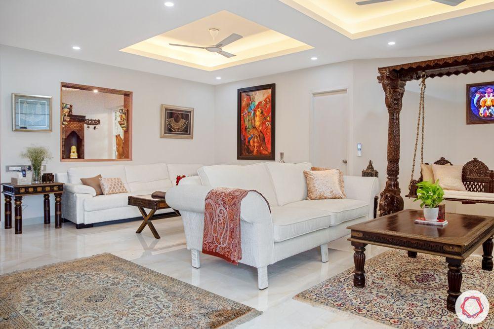 home interiors in chennai-swing set-wooden furniture-art work-white sofa