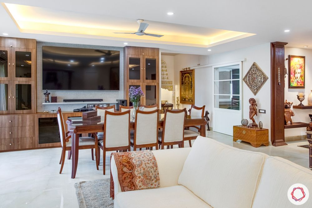 home interiors in chennai-wooden furniture-art work-white sofa-curios-artefacts