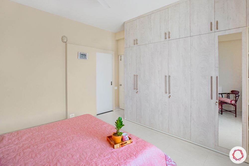 home interiors in chennai-armchair-beige walls-plywood wardrobes