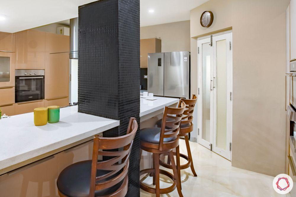 home interiors in chennai-kitchen cabinets-high chairs-kitchen island-kitchen
