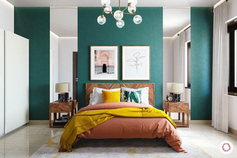 jewel toned interiors-green wall-mirror wall-orange bedding-pendant lighting