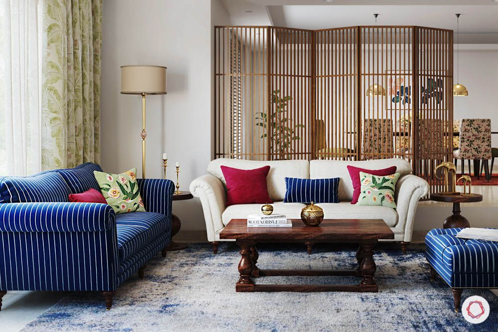 jewel toned interiors-wooden partition-white sofa-blue sofa-living room designs