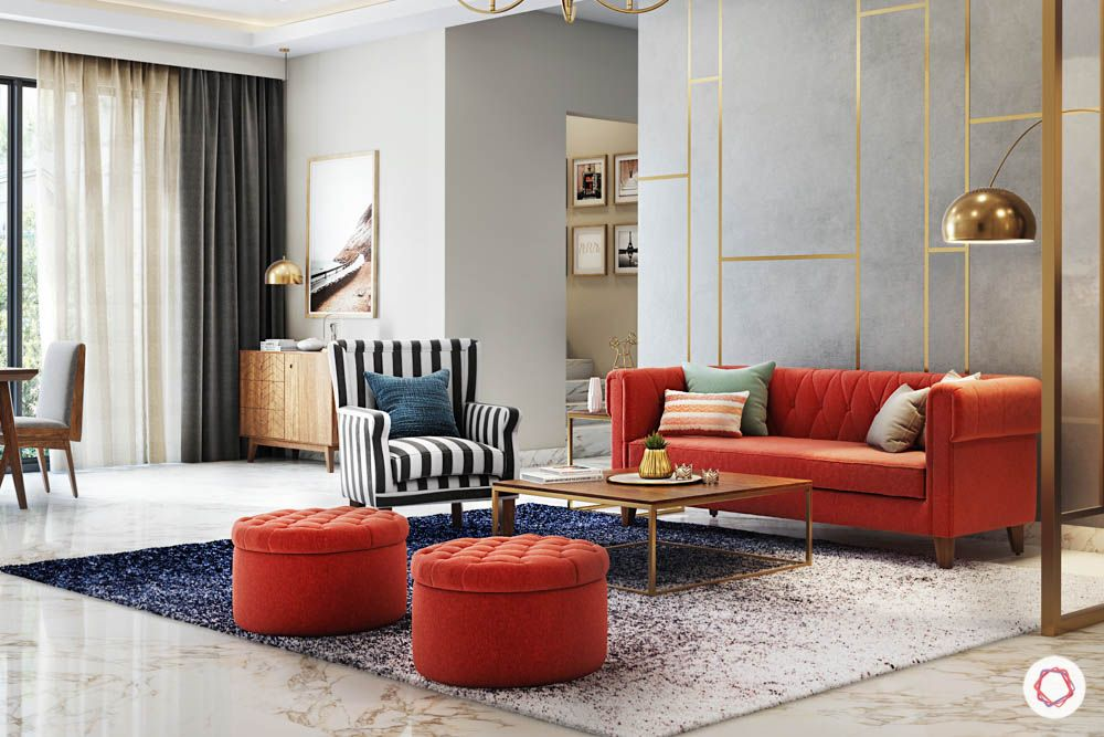 jewel toned interiors-orange sofa-partition designs-chandelier-entryway mirror
