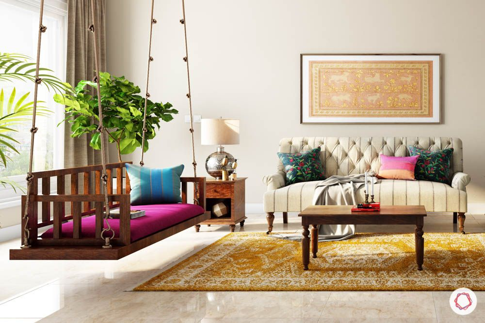 jewel toned interiors-living room swing-blue chairs-partition