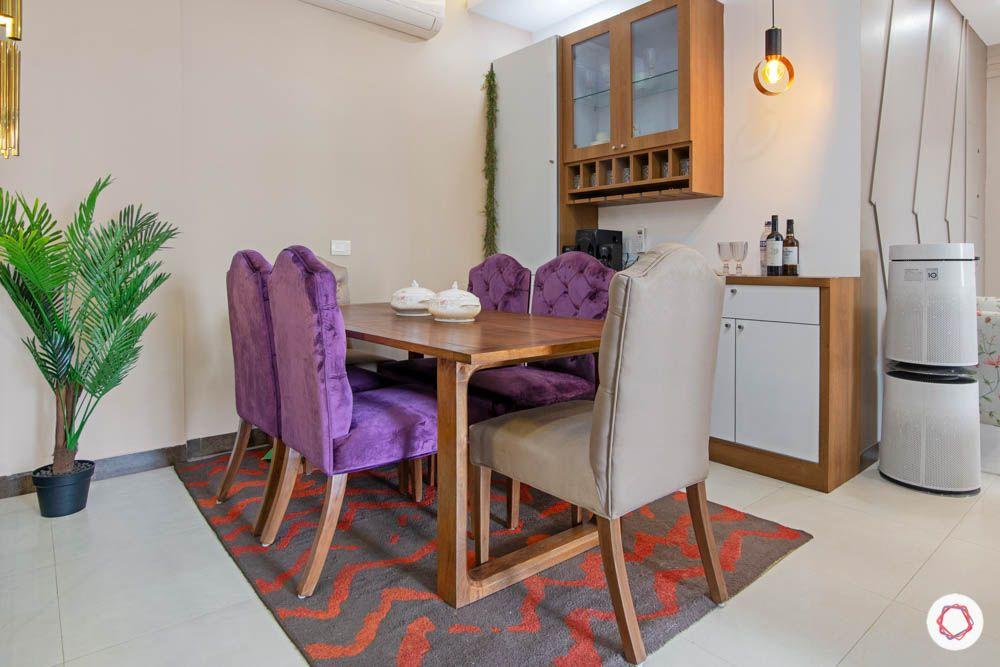 jewel toned interiors-velvet dining chairs-purple furniture-pendant lighting