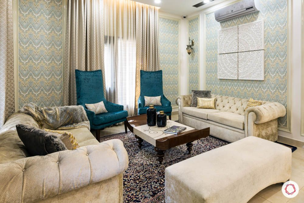 jewel toned interiors-blue chairs-white sofa-partition-blue wallpaper