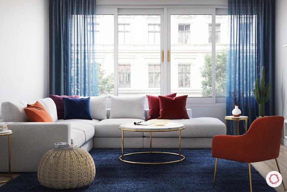 colors-blue curtains-white sofa-orange chair