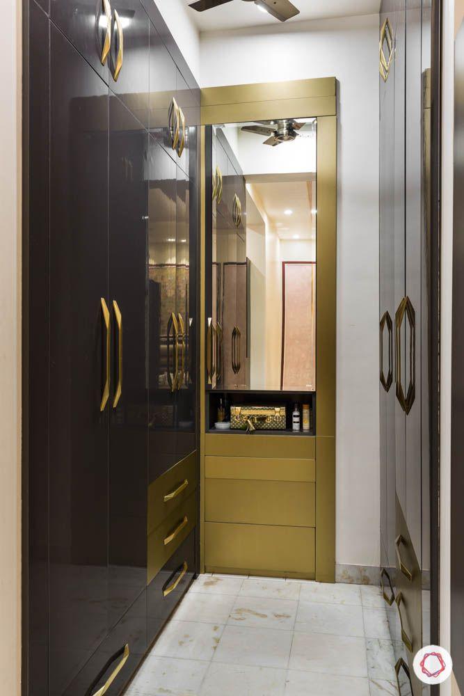 walk in closet-wardrobe designs-gold mirror vanity-black swing doors