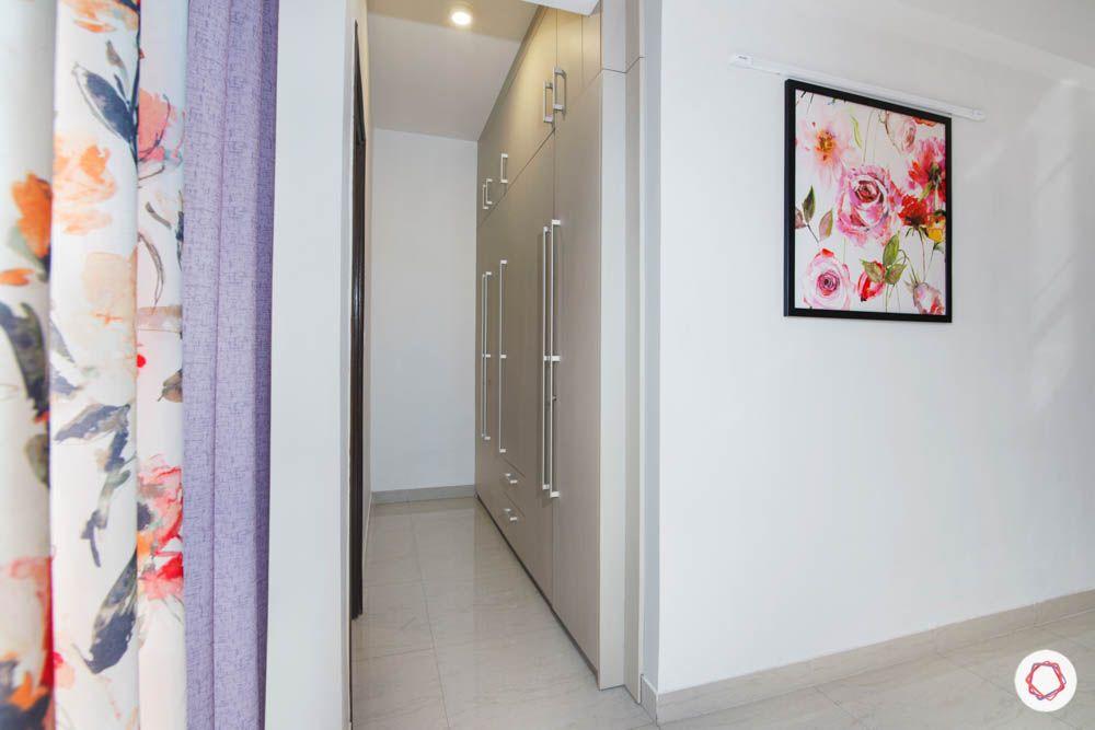 walk in closet-wardrobe designs-white swing doors-wall art