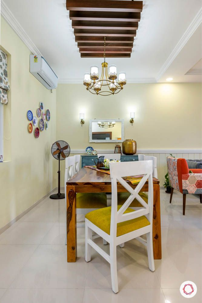 3BHK-design-dining-chairs-crockery-cabinet-mirror-wooden-rafters