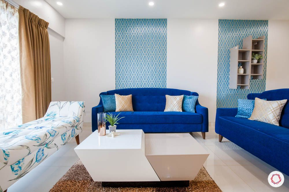 2-bhk-home-design-livspace-pune-living-room-blue-sofa-wallpaper