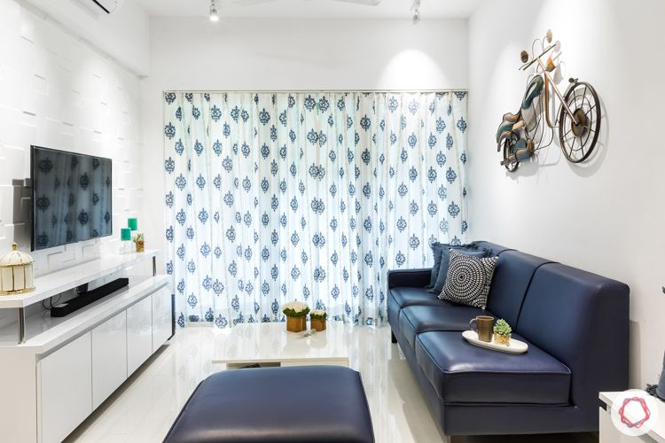 Living room colours-blue sofa-sheer curtains-motorcycle
