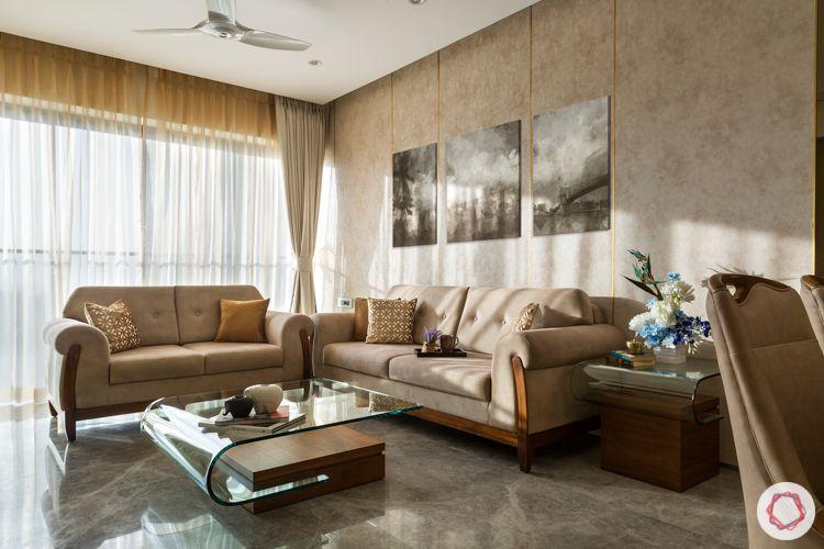 Beige wallpaper-beige sofas-glass center table