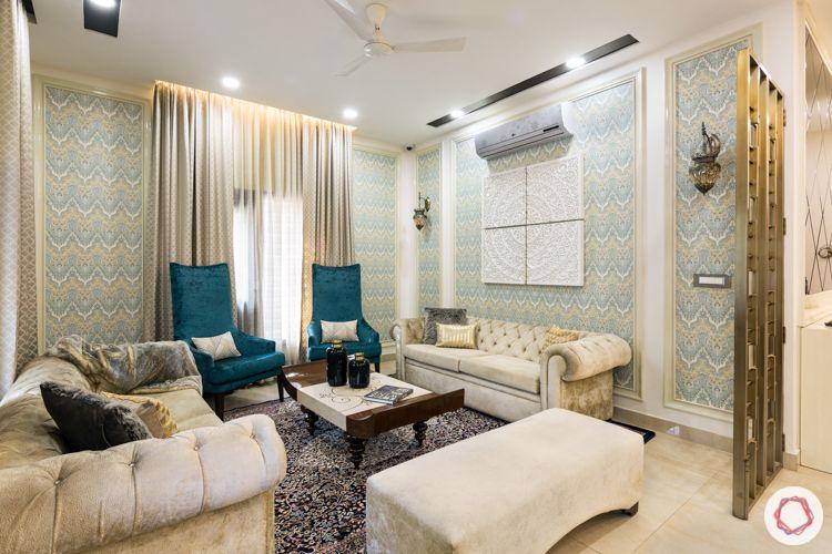 White velvet sofa-blue accent chairs-zigzag wallpaper