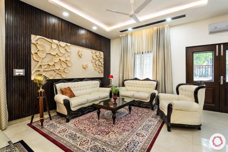 White sofa-wooden panelling-persian carpet
