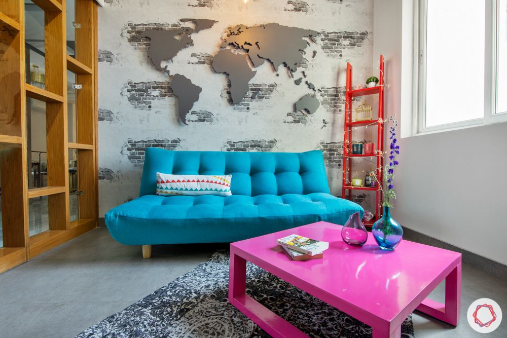 blue sofa-trends 2020-world map wall-futon sofa-pink coffee table