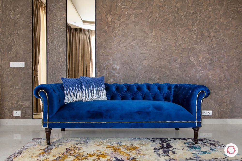 blue sofa-trends 2020- walls-chesterfield-pillows
