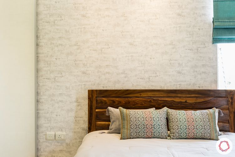 3 bhk apartment-master bedroom-exposed brick wallpaper-wooden bed