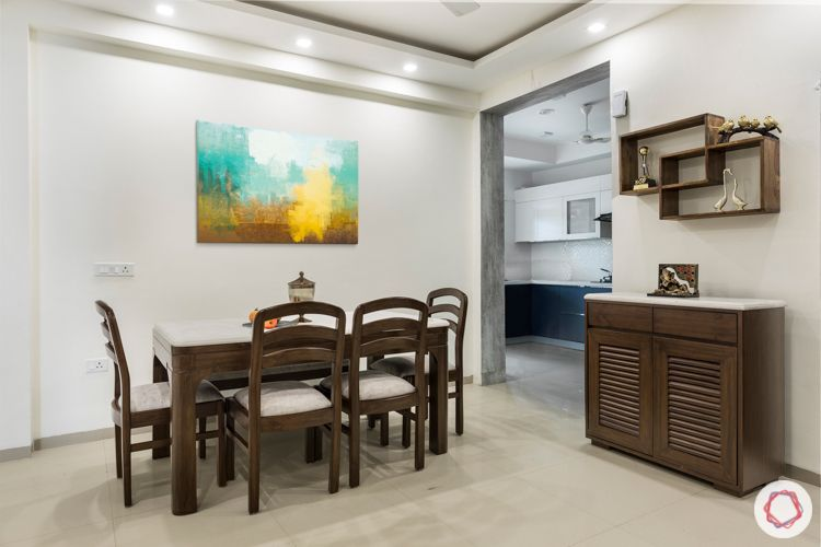 3 bhk apartment-dining room-wooden furniture-upholstered-artwork-crockery unit-display shelves