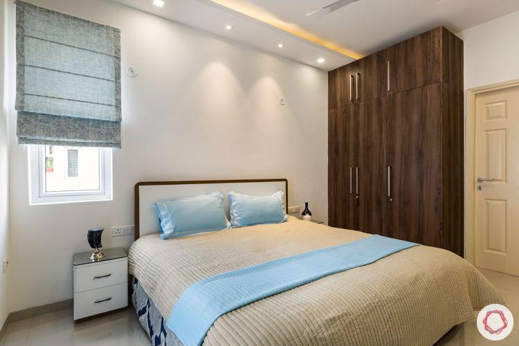 Wooden laminate wardrobe-loft-blue blinds-wooden bed-side table