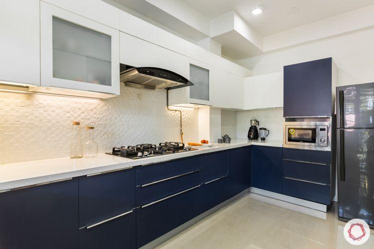 Membrane kitchen-white and navy-white tile backsplash-quartz countertop-tall unit