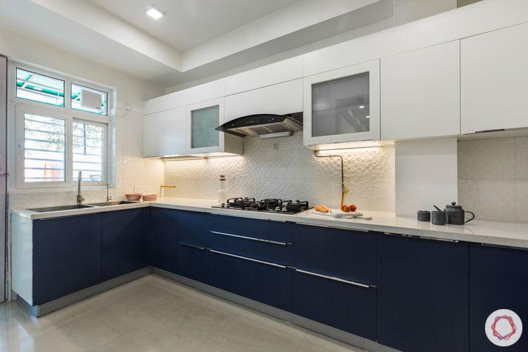 Membrane kitchen-white and navy-white tile backsplash-quartz countertop-sink-profile shutters