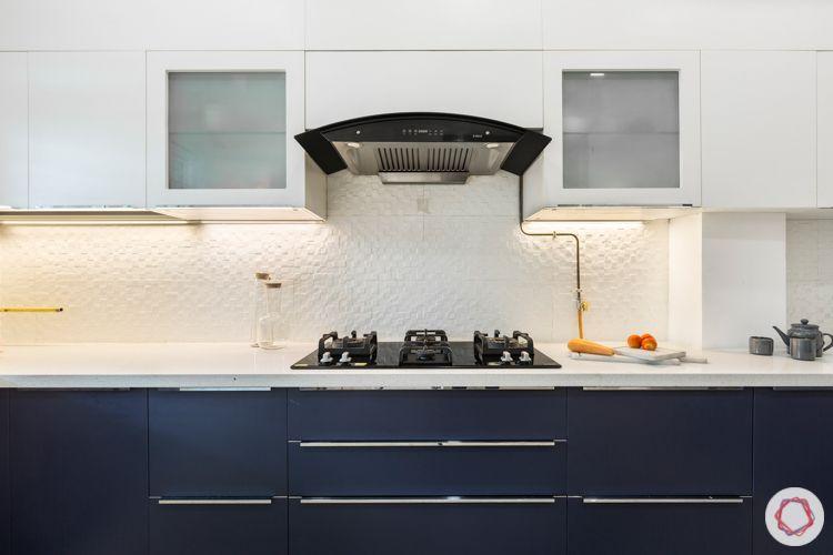 3 bhk apartment-membrane kitchen-white and navy-white tile backsplash-quartz countertop