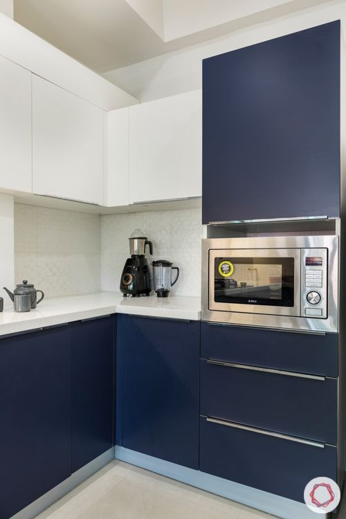 3 bhk apartment-membrane kitchen-white and navy-white tile backsplash-quartz countertop-tall unit
