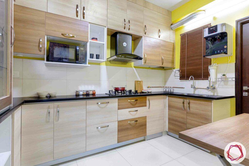 best interior designers in hyderabad-kitchen cabinets-wooden laminate-yellow wall