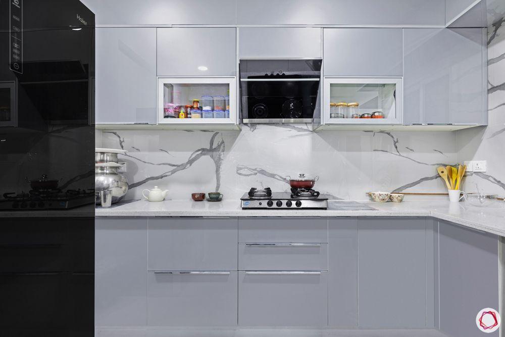 best interior designers in hyderabad-sleek grey kitchen-cabinets-marble backsplash