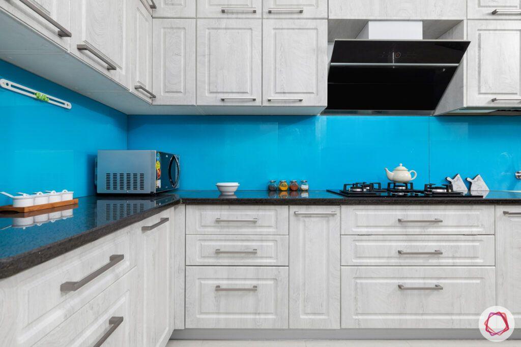 best interior designers in hyderabad-matte white cabinets-blue backsplash