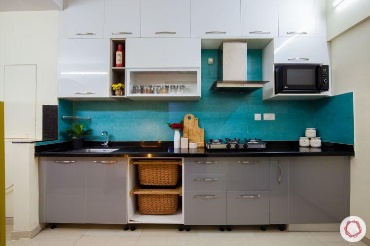kalpataru serenity-blue backsplash-kitchen basket-white and grey cabinets