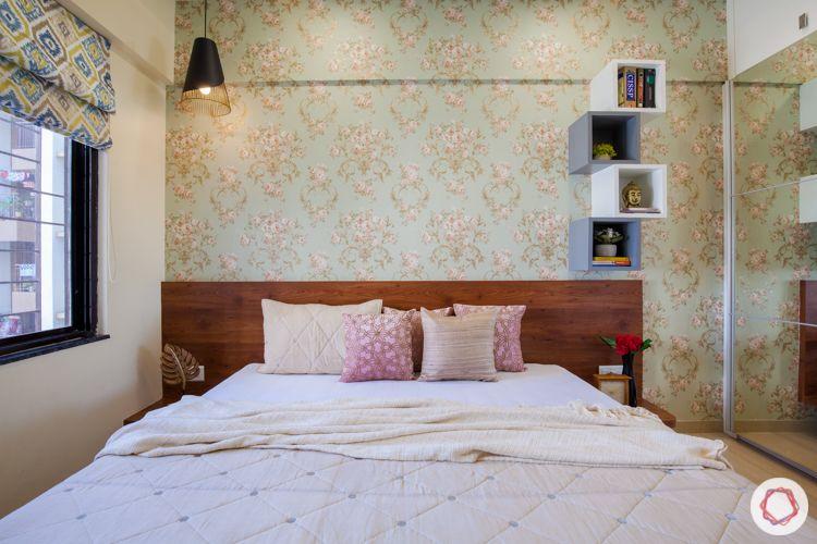 kalpataru serenity-wooden bed-floating shelves-pendant light