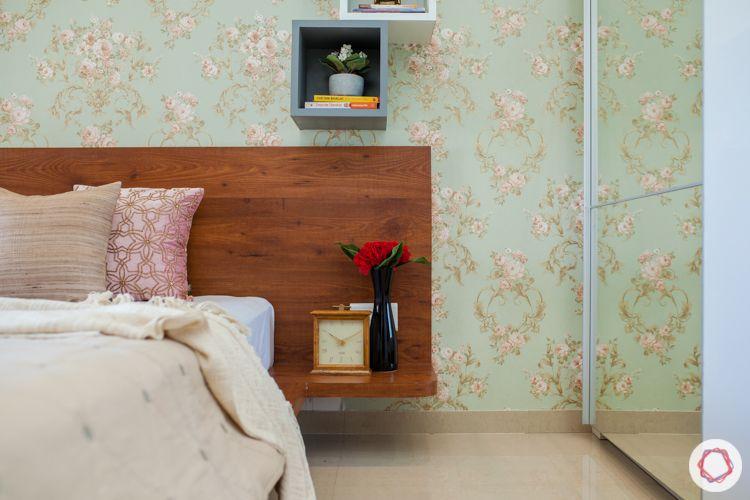 kalpataru serenity-pendant light-floral wallpaper-white wardrobes-floating shelves