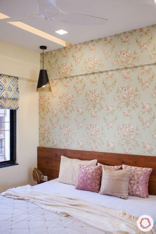 kalpataru serenity-y-pendant light-floral wallpaper-wooden bed