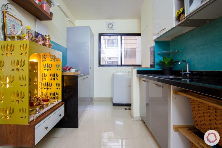 kalpataru serenity-blue backsplash-kitchen basket-white and grey cabinets-tall unit-pooja unit