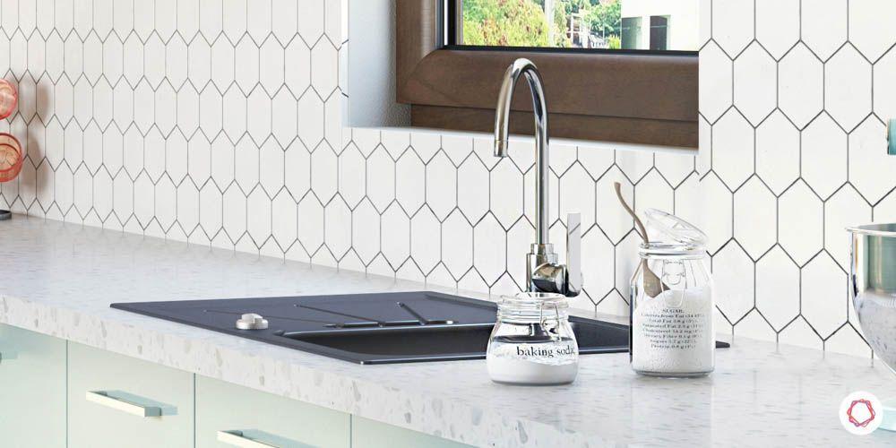 celebrity kitchens-sink with drainboard-patterned backsplash
