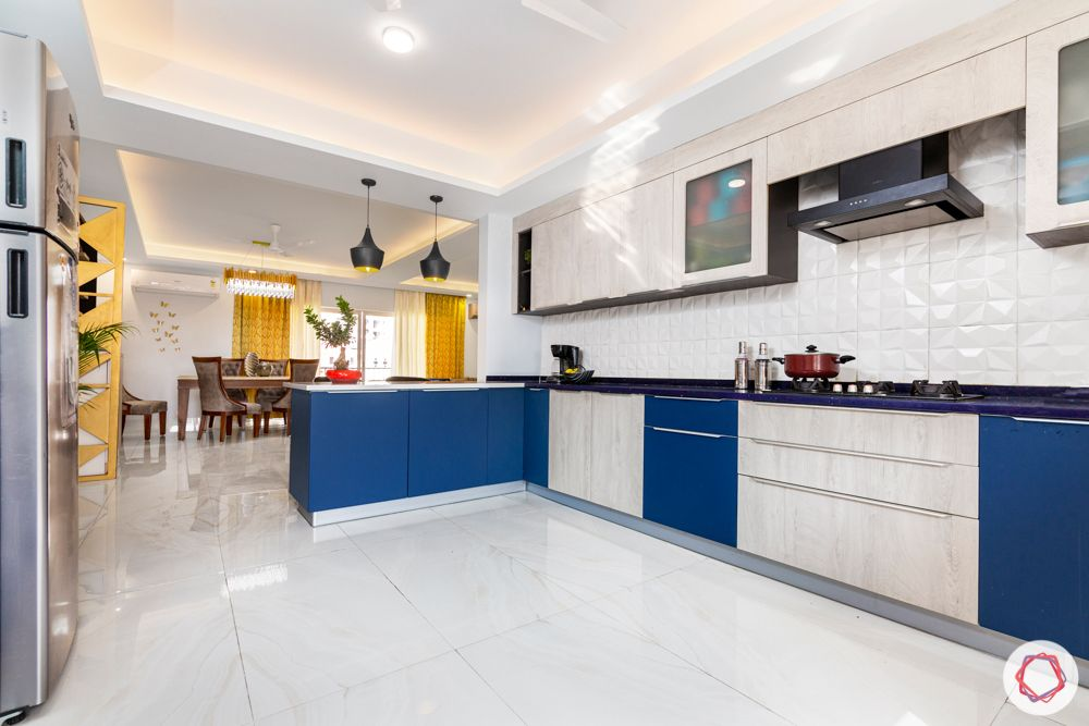4 bhk home design-blue and white cabinets-baskets-U-shaped layout