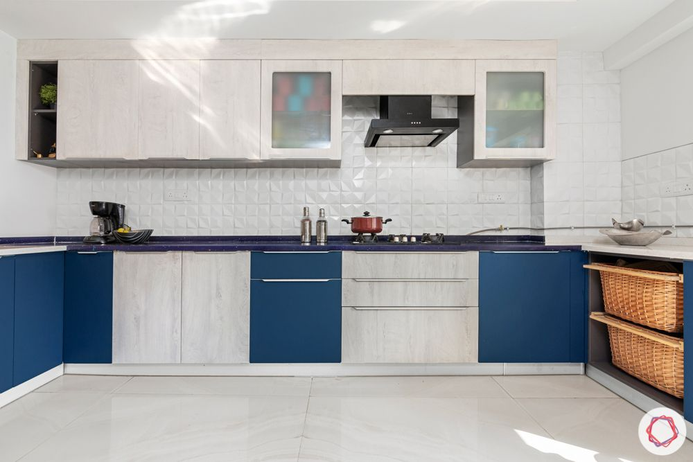 4 bhk home design-blue and white cabinets-baskets