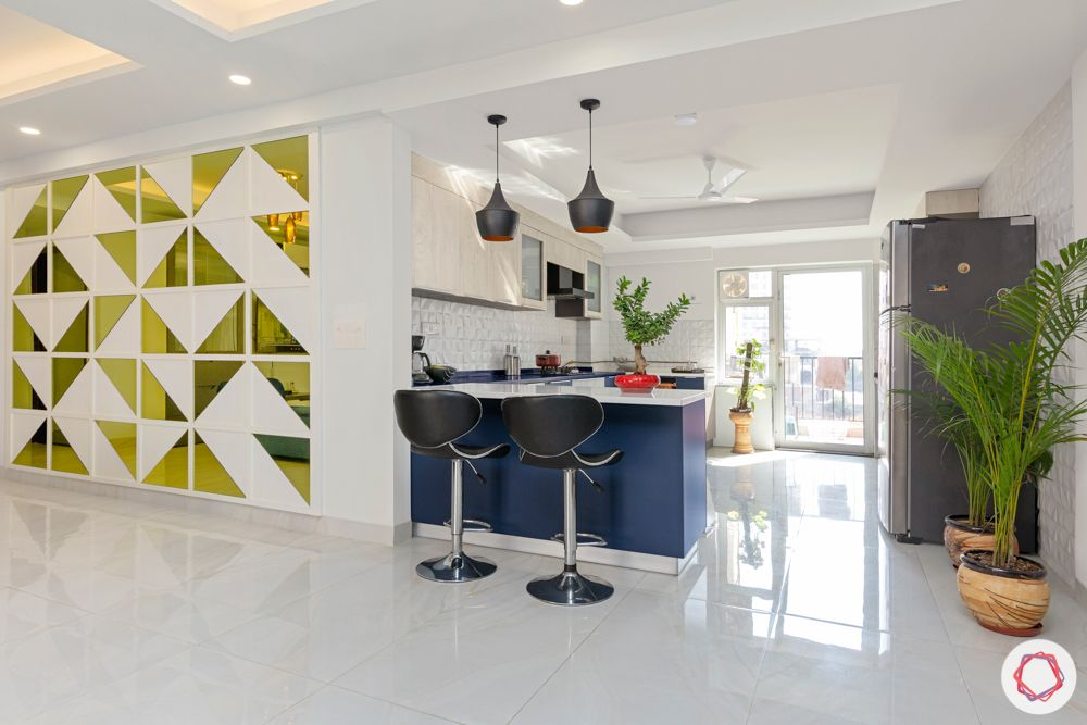 4 bhk home design-blue and white cabinets-baskets-breakfast counter-feature wall