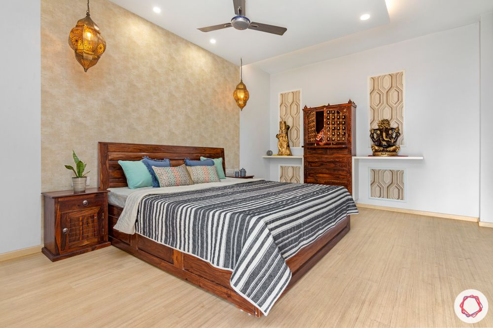 4 bhk home design-gold wallpaper-desi hanging lights-sheesham wood bed