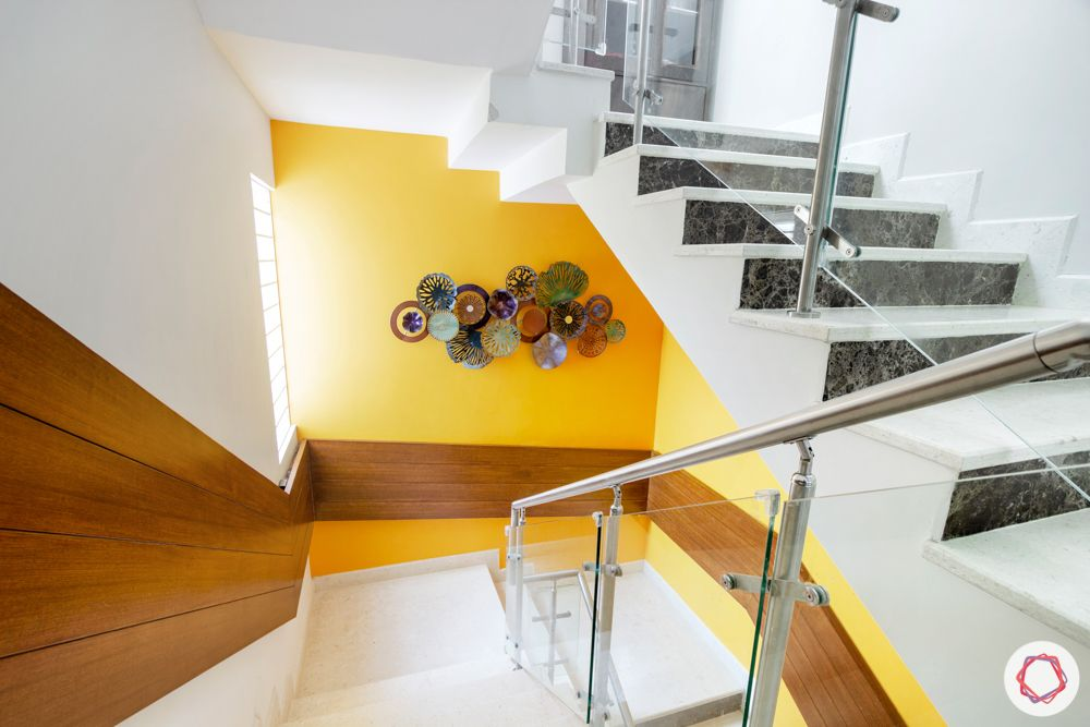 villa-interior-design-staircase-yellow-vastu-veneer-cladding
