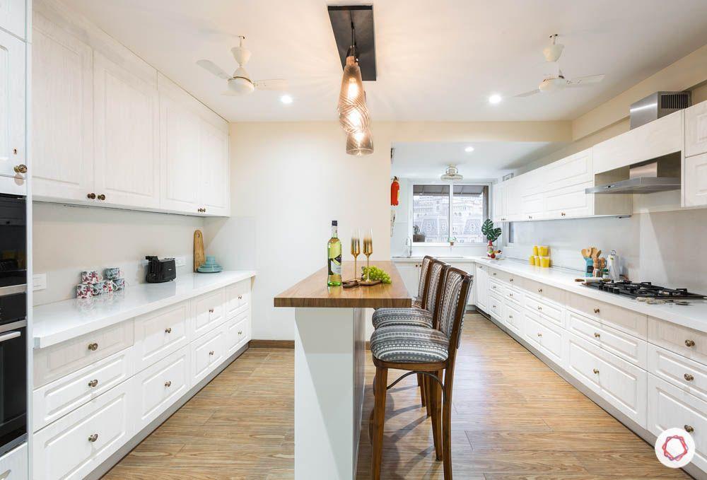 timeless kitchen designs- wooden flooring-white cabinets-kitchen island